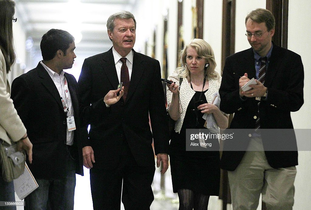 U.S. Sen. <a gi-track='captionPersonalityLinkClicked' href=/galleries/search?phrase=Max+Baucus&family=editorial&specificpeople=242972 ng-click='$event.stopPropagation()'>Max Baucus</a> (D-MT) (C) gestures as reporters ask him questions as he arrives for a meeting with a small group of members of the Joint Select Committee on Deficit Reduction at Sen. John Kerry 's (D-MA) office November 21, 2011 on Capitol Hill in Washington, DC. It's been reported that the committee has failed to come up with a plan to cut at least $1.2 trillion of the federal deficit over the next ten years.