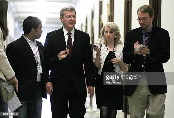 S Sen Max Baucus gestures as reporters ask him questions as he arrives for a meeting with a small group of members of the Joint Select Committee on...