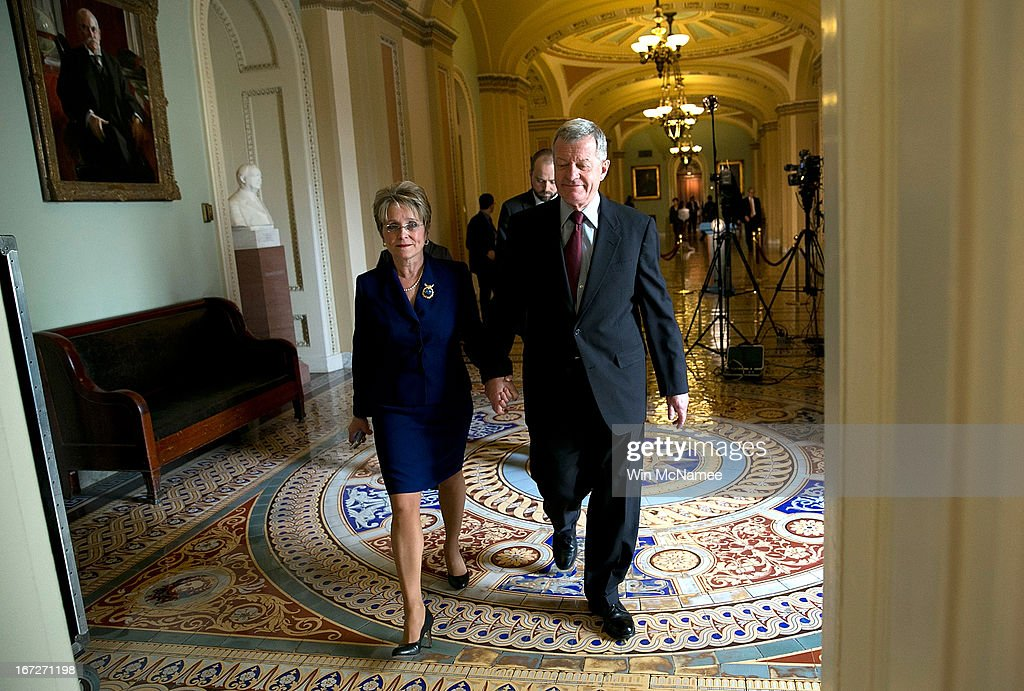 Sen. Max Baucus (D-MT) (R) walks with his wife Melodee Hanes at the U.S. Capitol April 23, 2013 in Washington, DC. It was announced earlier that Baucus, after 36 years in the Senate, will not seek reelection in 2014.