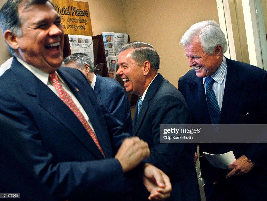 U.S. Sen. Mel Martinez (R-FL), Sen. <a gi-track='captionPersonalityLinkClicked' href=/galleries/search?phrase=Lindsey+Graham&family=editorial&specificpeople=240214 ng-click='$event.stopPropagation()'>Lindsey Graham</a> (R-SC) and Sen. Ted Kennedy (D-MA) laugh before a news conference to announce a compromise on immigration legislation between the White House and the Senate at the U.S. Capitol May 17, 2007 in Washington, DC. Kennedy was key in negotiating the compromise language in the bill, which U.S. President George W. Bush is expected to sign.
