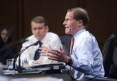 Sen Michael Bennet DColo listens as Sen Richard Blumenthal DConn speaks during the Senate Health Education Labor and Pensions Committee markup of the...