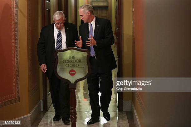 Sen Mike Enzi and Sen Ron Johnson leave a Republican Senate caucus meeting at the US Capitol September 30 2013 in Washington DC If House Republicans...
