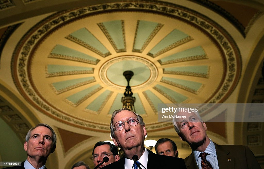 Sen. Mitch McConnell (C) (R-KY) answers questions following a weekly policy luncheon at the U.S. Capitol on March 11, 2014 in Washington, DC. Also pictured (L-R) are Sen. Rob Portman (R-OH), Sen. John Barrasso (R-WY), Sen. John Thune (R-SD) and Sen. John Cornyn (R-TX).