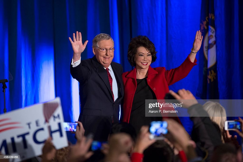 U.S. Sen. Mitch McConnell (R-KY) celebrates with his wife Elaine Chao at his election night event November 4, 2014 in Louisville, Kentucky. McConnell defeated Kentucky Secretary of State Alison Lundergan Grimes.
