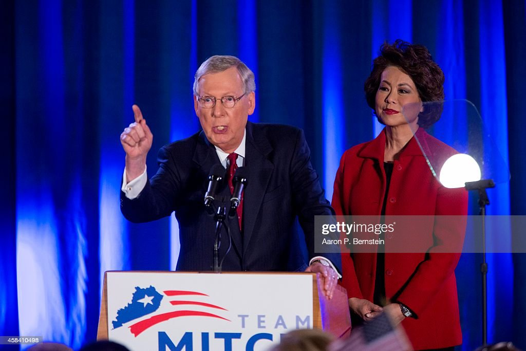 U.S. Sen. <a gi-track='captionPersonalityLinkClicked' href=/galleries/search?phrase=Mitch+McConnell&family=editorial&specificpeople=217985 ng-click='$event.stopPropagation()'>Mitch McConnell</a> (R-KY) speaks accompanied by his wife <a gi-track='captionPersonalityLinkClicked' href=/galleries/search?phrase=Elaine+Chao&family=editorial&specificpeople=568353 ng-click='$event.stopPropagation()'>Elaine Chao</a> at his election night event November 4, 2014 in Louisville, Kentucky. McConnell defeated Kentucky Secretary of State Alison Lundergan Grimes.