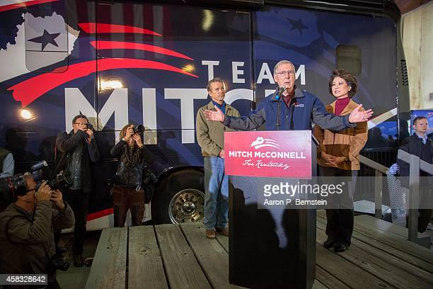 S Sen Mitch McConnell speaks during his campaign event as US Sen Rand Paul and McConnell's wife Elaine Chao look on and at Bowman Field November 3...