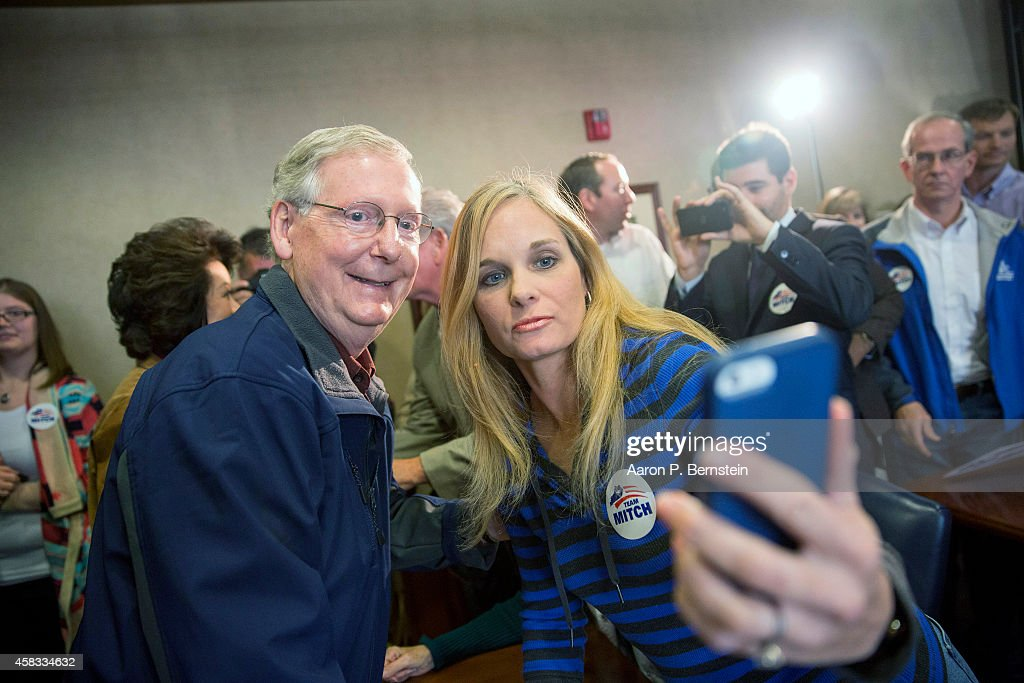 S Sen Mitch McConnell takes a photo with a supporter following an election rally at Bluegrass Airport November 3 2014 in Lexington Kentucky Heading...