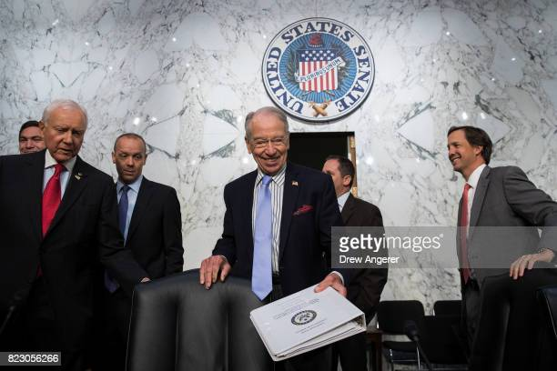 Sen Orrin Hatch and committee chairman Sen Chuck Grassley arrive for a Senate Judiciary Committee hearing titled 'Oversight of the Foreign Agents...