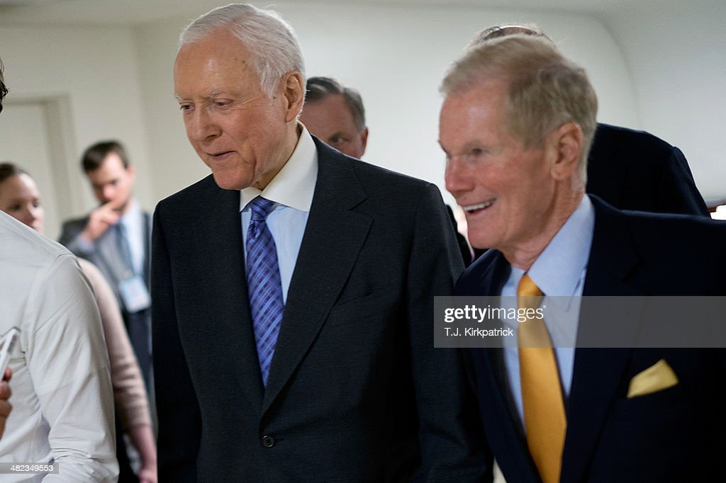 Sen. Orrin Hatch (R-UT), left, walks with Sen. <a gi-track='captionPersonalityLinkClicked' href=/galleries/search?phrase=Bill+Nelson+-+Florida+Senator&family=editorial&specificpeople=13672972 ng-click='$event.stopPropagation()'>Bill Nelson</a> (D-FL) as Senators head to the Chamber to vote on the Reed-Heller unemployment insurance bill on April 3, 2014 in Washington, DC. The bill, which cleared a final hurdle and is expected to pass the Senate on Monday, would reinstate emergency unemployment insurance benefits for five months.
