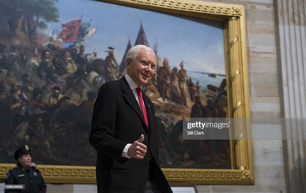 Sen. Orrin Hatch, R-Utah, gives a thumbs up as he arrives for the luncheon in Statuary Hall during President Barack Obama's inauguration ceremony on Monday, Jan. 21, 2013.