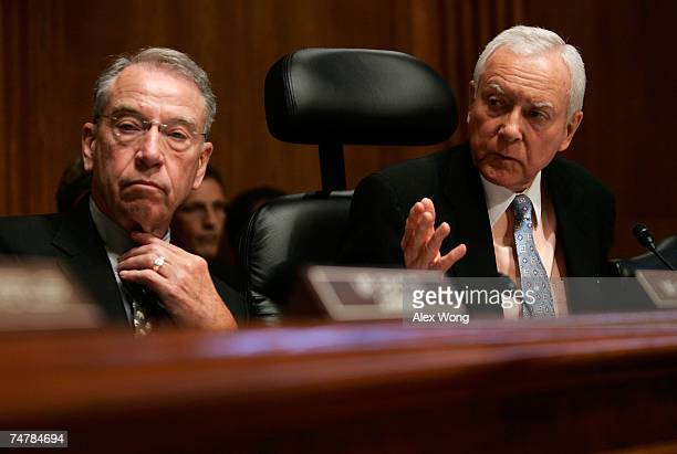 S Sen Orrin Hatch speaks as Sen Chuck Grassley s listens during a Senate Finance Committee markup of the 'Energy Advancement and Investment Act of...