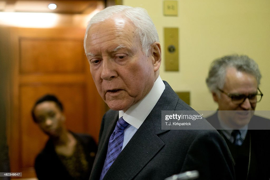 Sen. Orrin Hatch (R-UT) talks with reporters on his way to the Senator Chamber to vote on the Reed-Heller unemployment insurance bill on April 3, 2014 in Washington, DC. The bill, which cleared a final hurdle and is expected to pass the Senate on Monday, would reinstate emergency unemployment insurance benefits for five months.