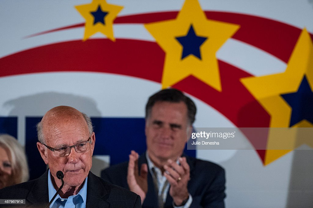 U.S. Sen. <a gi-track='captionPersonalityLinkClicked' href=/galleries/search?phrase=Pat+Roberts&family=editorial&specificpeople=213805 ng-click='$event.stopPropagation()'>Pat Roberts</a> (R-KS) is applauded by Former Massachusetts Former Massachusetts Gov. <a gi-track='captionPersonalityLinkClicked' href=/galleries/search?phrase=Mitt+Romney&family=editorial&specificpeople=207106 ng-click='$event.stopPropagation()'>Mitt Romney</a> as he speaks during a rally at the Prairie Fire shopping center October 27, 2014 in Overland Park, Kansas. Ahead of Midterm Elections, a number of national Republican political figures have traveled through Kansas to stump for Roberts who is facing a close race with independent Greg Orman.