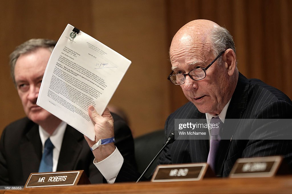 U.S. Sen. <a gi-track='captionPersonalityLinkClicked' href=/galleries/search?phrase=Pat+Roberts&family=editorial&specificpeople=213805 ng-click='$event.stopPropagation()'>Pat Roberts</a> (R-KS) questions current and former IRS employees while the testify before the Senate Finance Committee May 21, 2013 in Washington, DC. The committee heard testimony on the topic of on 'A Review of Criteria Used by the IRS to Identify 501(c)(4) Applications for Greater Scrutiny.'