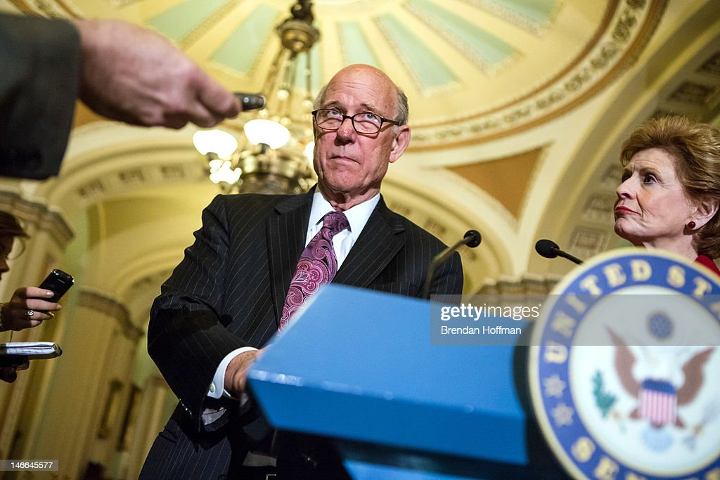 Sen. <a gi-track='captionPersonalityLinkClicked' href=/galleries/search?phrase=Pat+Roberts&family=editorial&specificpeople=213805 ng-click='$event.stopPropagation()'>Pat Roberts</a> (R-KS), ranking member of the Senate Agriculture Committee (L), and Sen. <a gi-track='captionPersonalityLinkClicked' href=/galleries/search?phrase=Debbie+Stabenow&family=editorial&specificpeople=221624 ng-click='$event.stopPropagation()'>Debbie Stabenow</a> (D-MI), chair of the Senate Agriculture Committee, speak at a news conferece on Capitol Hill on June 21, 2012 in Washington, DC. The Senate passed its version of the farm bill, which will now have to be merged with a House version before final passage.