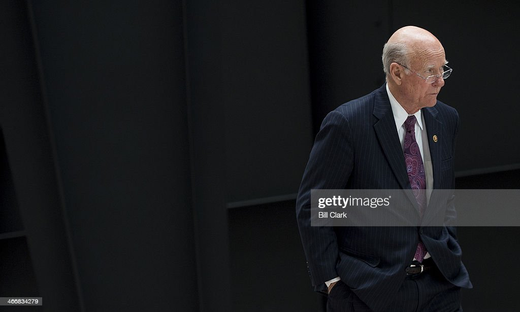 Sen. Pat Roberts, R-Kan., walks past the 'Mountains and Clouds' sculpture in the atrium of the Hart Senate Office Building on Tuesday, Feb. 4, 2014.