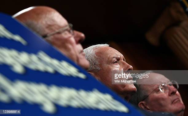 Sen Pat Roberts Sen Orrin Hatch and Sen Lamar Alexander listen during a press conference urging US President Barack Obama to submit pending trade...
