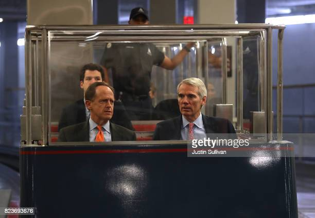 S Sen Pat Toomey and Sen Rob Portman ride a Senate subway to the US Capitol before allnight voting July 27 2017 in Washington DC Senate Republicans...