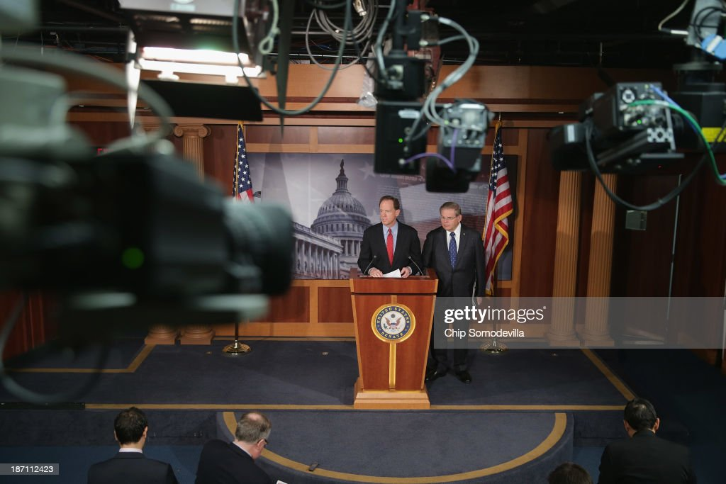 Sen. Pat Toomey (R-PA) (L) and Sen. Robert Menendez (D-NJ) hold a news conference to introduce the Start-Up Jobs and Innovation Act at the U.S. Capitol November 6, 2013 in Washington, DC. According to the senators, the bipartisan legislation 'would make it easier for entrepreneurs to start and grow a small business and to help them comply with burdensome tax rules.'