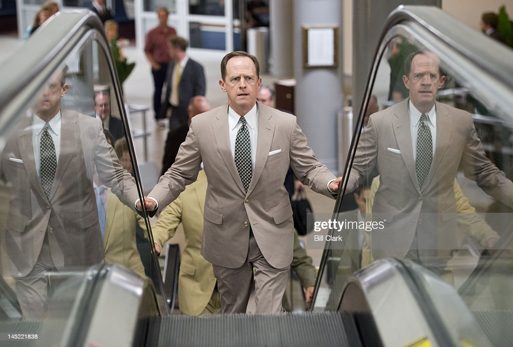 Sen. Pat Toomey, R-Pa., arrives in the Capitol via the Senate subway for votes on the Food and Drug Administration reauthorization bill on Thursday, May 24, 2012.