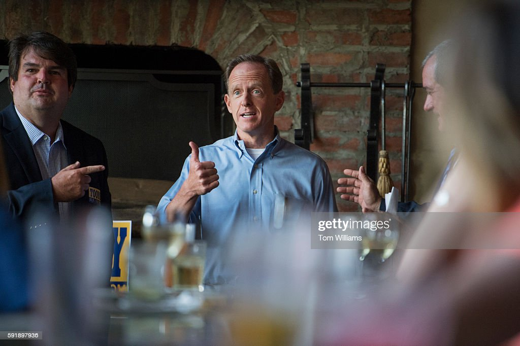 Sen Pat Toomey RPa center talks with Centre County GOP Chairman Steve Miller left and Centre County Commissioner Steve Dershem at Champs Sports Grill...