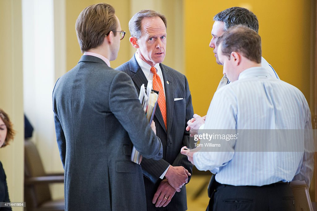 Sen. <a gi-track='captionPersonalityLinkClicked' href=/galleries/search?phrase=Pat+Toomey&family=editorial&specificpeople=3370648 ng-click='$event.stopPropagation()'>Pat Toomey</a>, R-Pa., speaks with aides before the Senate policy luncheons in the Capitol, April 28, 2015.
