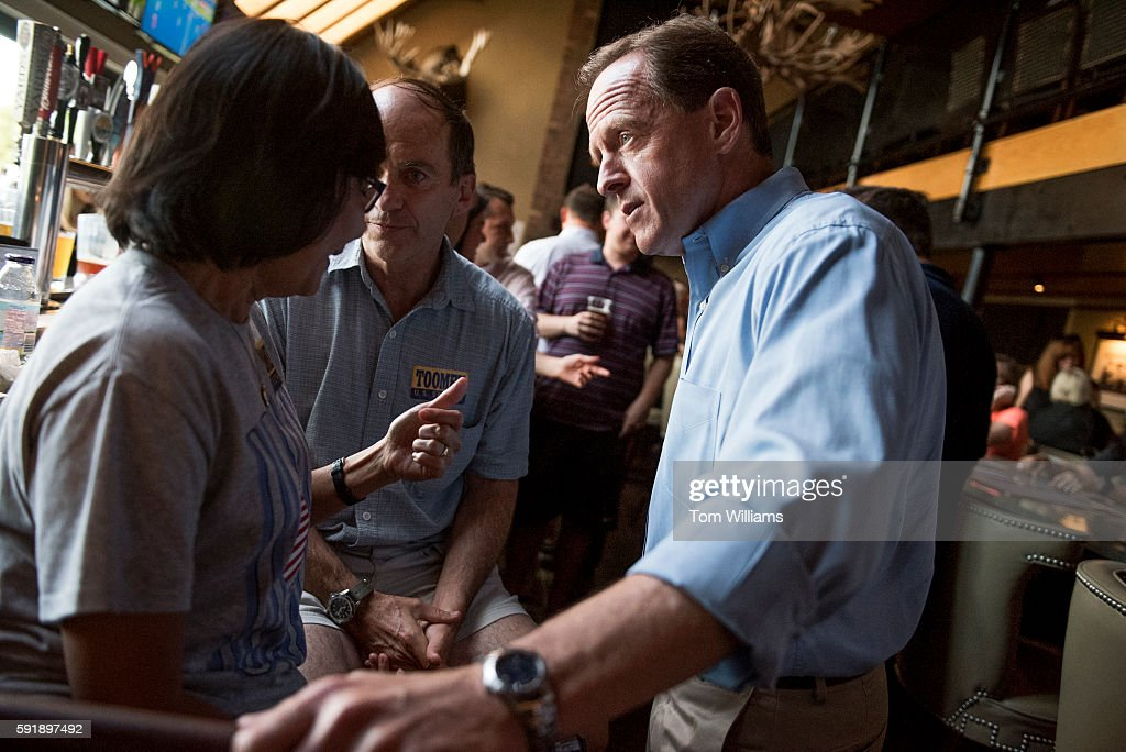 Sen Pat Toomey RPa talks with constituents at Champs Sports Grill in State College Pa during his statewide bus tour August 16 2016