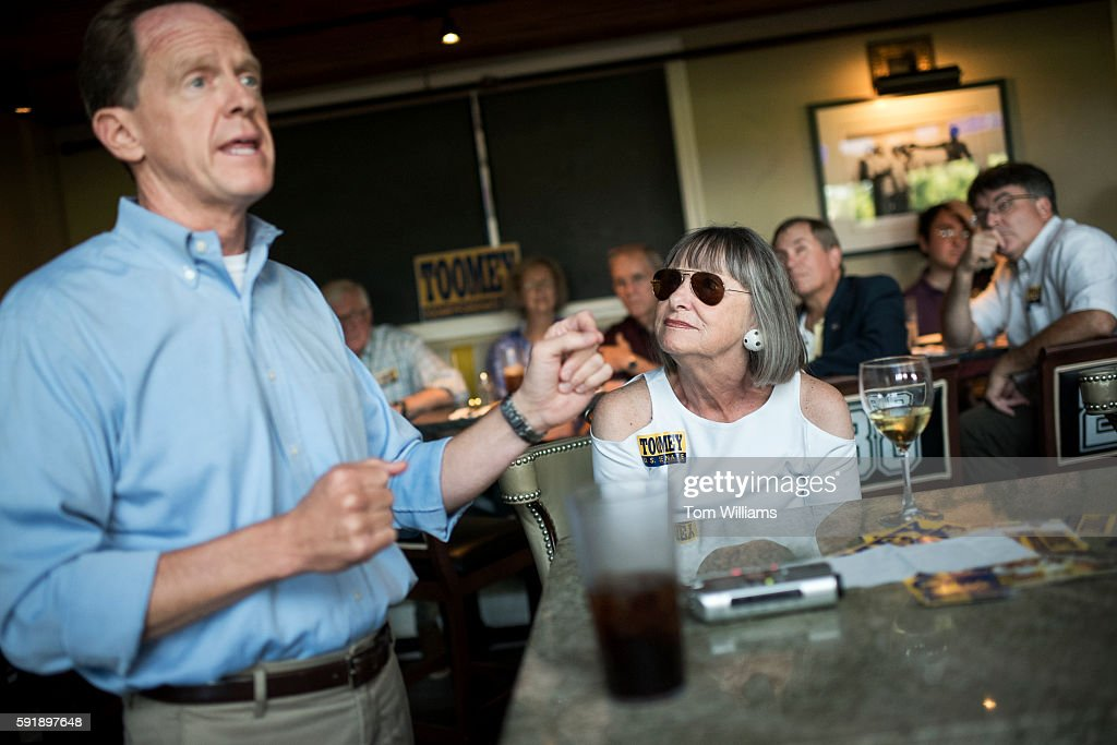 Sen Pat Toomey RPa talks with constituents including Judith Wilson at Champs Sports Grill in State College Pa during his statewide bus tour August 16...