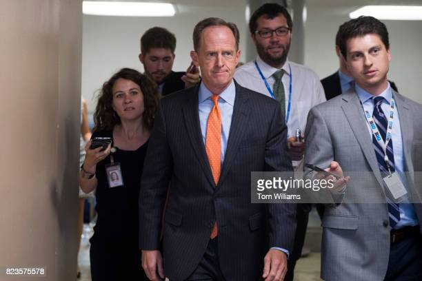 Sen Pat Toomey RPa talks with reporters in the senate subway before a lunch in the Capitol on July 27 2017