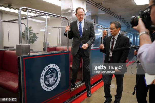 Sen Pat Toomey steps off the Senate subway as he heads for the GOP policy luncheon at the US Capitol November 14 2017 in Washington DC Senate...