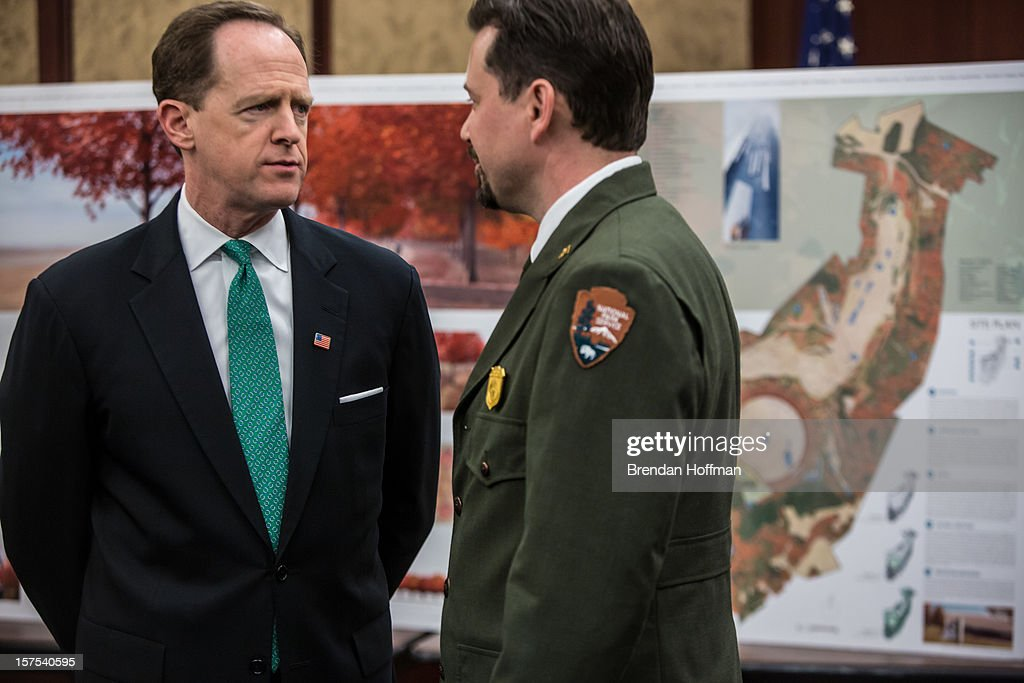 U.S. Sen. Pat Toomey (R-PA) (L) talks with Jeff Reinbold, superintendent of the Flight 93 National Memorial, at an event on Capitol Hill to raise awareness of the unfinished national memorial to the passengers and crew of Flight 93 on December 4, 2012 in Washington, DC. The plane was hijacked on September 11 but passengers and crew fought back, crashing the plane into a field in Shanksville, Pennsylvania.