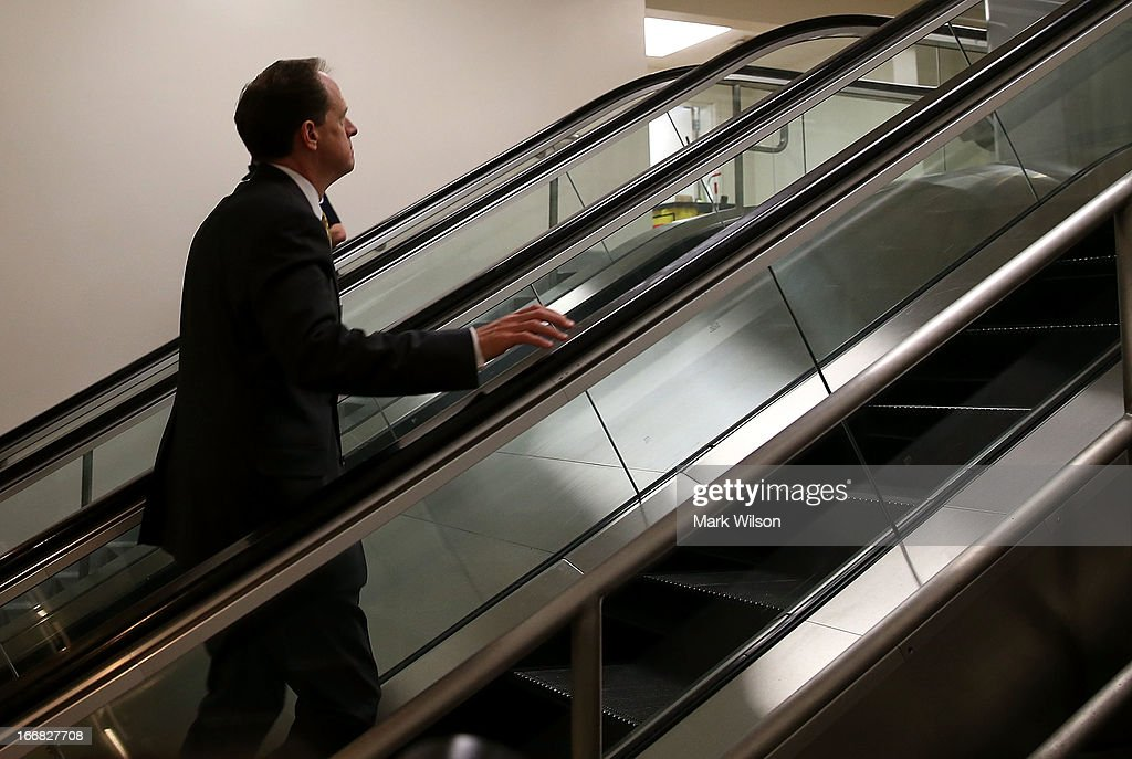 U.S. Sen. Pat Toomey (R-PA) walks to vote on the Senate floor April 17, 2013 on Capitol Hill in Washington, DC. The Senate rejected a proposal by Sens. Toomey and Joe Manchin (D-WV) to expand background checks on firearms purchases and to close the so-called gun-show loophole.