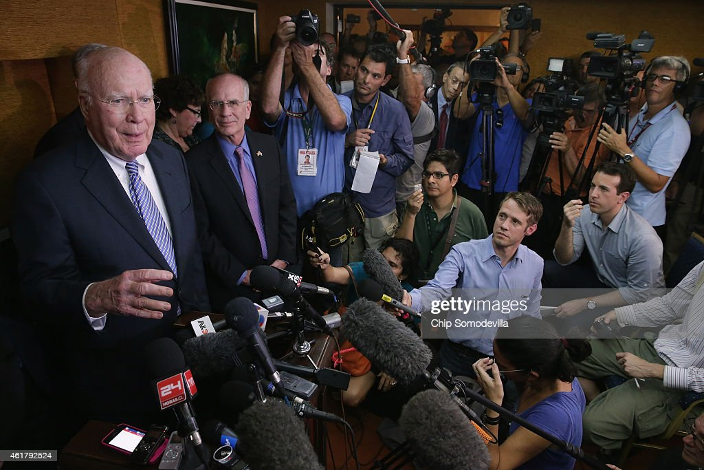 U.S. Sen. Patrick Leahy (D-VT) (L) and Rep. Peter Welch (D-VT) (2L) and other Democratic members of Congress talk to journalists assembled for a news conference at the Hotel Saratoga January 19, 2015 in Havana, Cuba. The members of Congress were part of a five-person delegation who visited Cuba for three days and met with the foreign minister, other government officials and some political dissidents.
