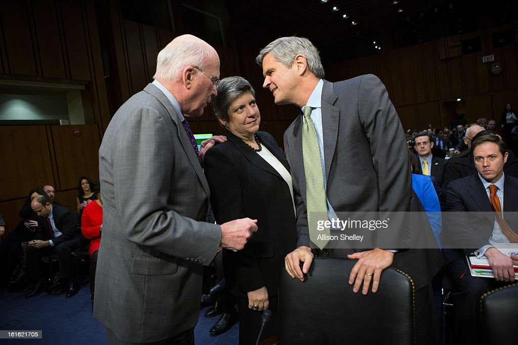 Sen. Patrick Leahy (D-VT), Homeland Security Secretary <a gi-track='captionPersonalityLinkClicked' href=/galleries/search?phrase=Janet+Napolitano&family=editorial&specificpeople=589781 ng-click='$event.stopPropagation()'>Janet Napolitano</a> and Steve Case, chairman and CEO of Revolution, Washington, D.C., chat before Napolitano's testimony before a Senate Judiciary Committee hearing on 'Comprehensive Immigration Reform' on Capitol February 13, 2013 Hill in Washington D.C. A number of protesters were taken out of the hearing room after causing disruptions.