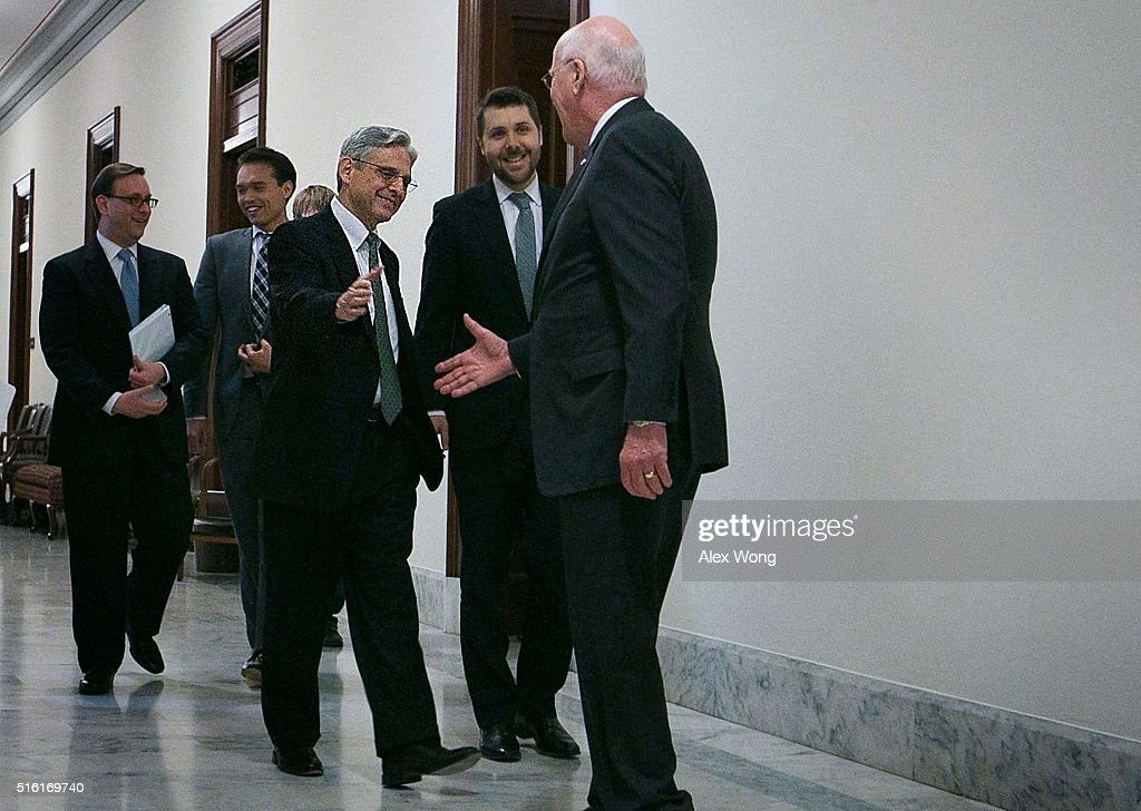 U.S. Sen. Patrick Leahy (D-VT) (R), ranking member of Senate Judiciary Committee, greets Supreme Court nominee Merrick Garland (L) March 17, 2016 on Capitol Hill in Washington, DC. Garland is visiting two Senate Democrats after heÕs nominated by President Barack Obama to succeed the late Justice Antonin Scalia.