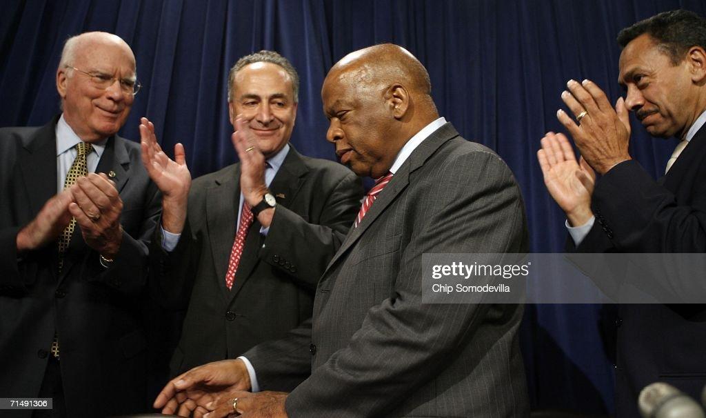 Sen Patrick Leahy Sen Charles Schumer and Rep Mel Watt applaud Rep John Lewis during a press conference at the US Capitol July 20 2006 in Washington...