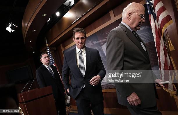 Sen Patrick Leahy Sen Jeff Flake and Sen John Boozman depart a press conference regarding Cuba at the US Capitol January 29 2015 in Washington DC...