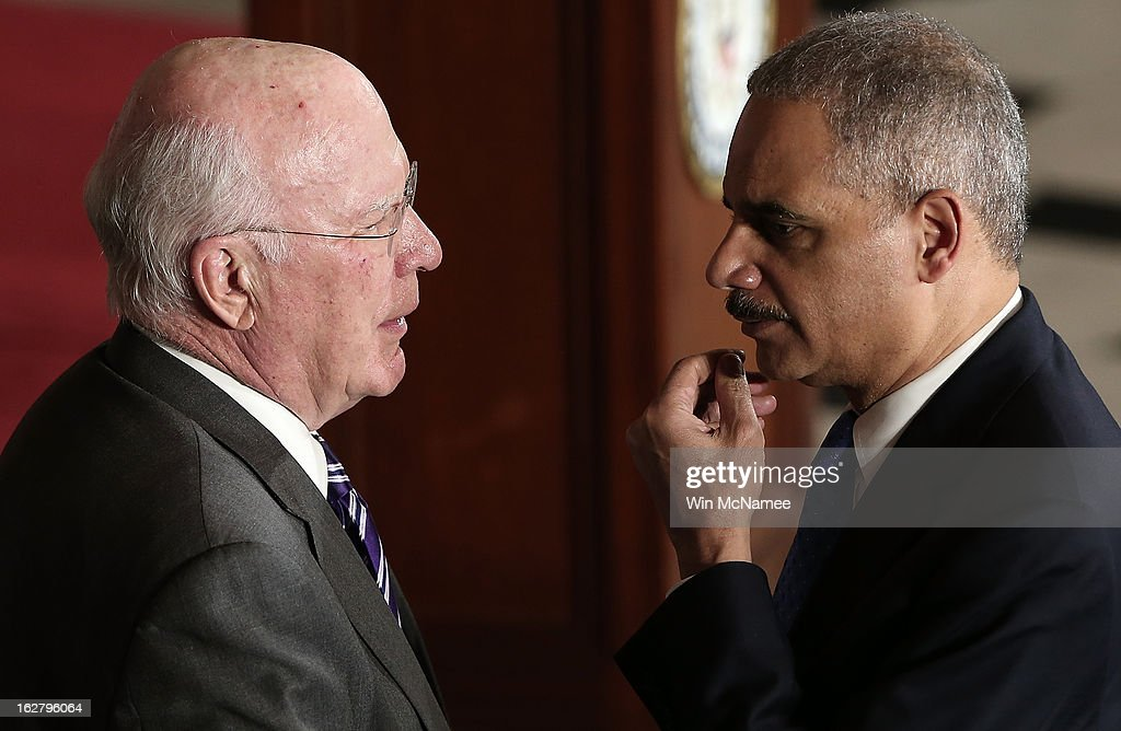 Sen. Patrick Leahy (L) (D-VT) speaks with U.S. Attorney General <a gi-track='captionPersonalityLinkClicked' href=/galleries/search?phrase=Eric+Holder&family=editorial&specificpeople=1060367 ng-click='$event.stopPropagation()'>Eric Holder</a> during a ceremony to unveil a statue honoring the late civil rights activist Rosa Parks in Statutory Hall of the U.S. Capitol February 27, 2013 in Washington, DC. U.S. President Barack Obama and Republican congressional leaders are still trying to find a solution to avert mandatory cuts caused by sequestration in two days.