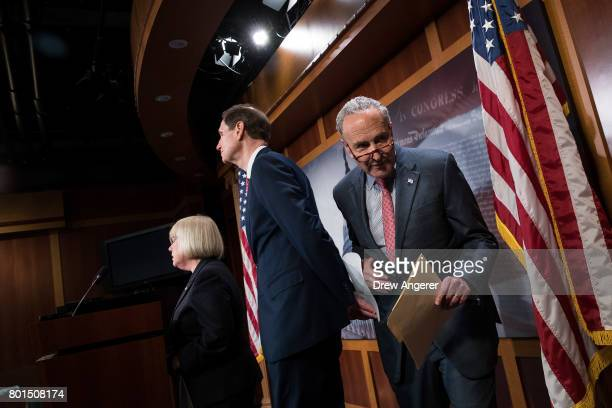 Sen Patty Murray and Sen Ron Wyden take questions as Senate Minority Leader Chuck Schumer exits a press conference about the Senate Republican health...