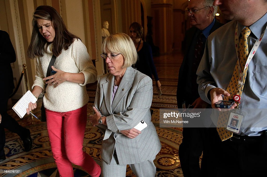 Sen. <a gi-track='captionPersonalityLinkClicked' href=/galleries/search?phrase=Patty+Murray&family=editorial&specificpeople=532963 ng-click='$event.stopPropagation()'>Patty Murray</a> (D-WA), Chairman of the Senate Budget Committee, talks with reporters while walking to Senate Majority Leader Harry Reid's office at the U.S. Capitol October 11, 2013 in Washington, DC. The U.S. government shutdown is in its eleventh day as the U.S. Senate and House of Representatives remain gridlocked on funding the federal government.