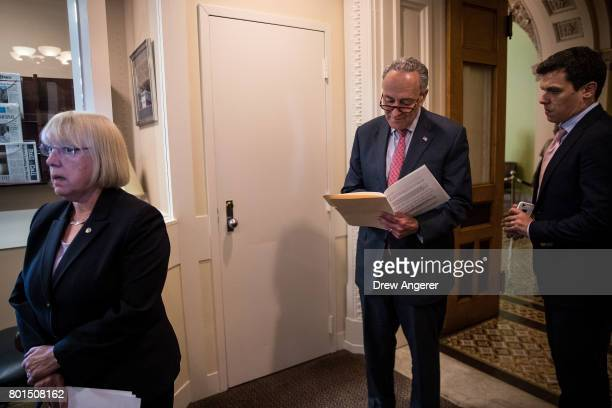 Sen Patty Murray looks on as Senate Minority Leader Chuck Schumer goes over notes before a press conference about the Senate Republican health care...