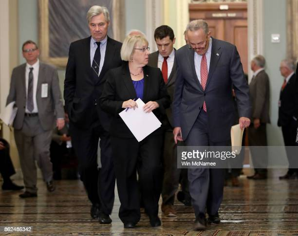 Sen Patty Murray walks with Senate Minority Leader Chuck Schumer and Sen Sheldon Whitehouse following the weekly Democratic policy luncheon at the US...