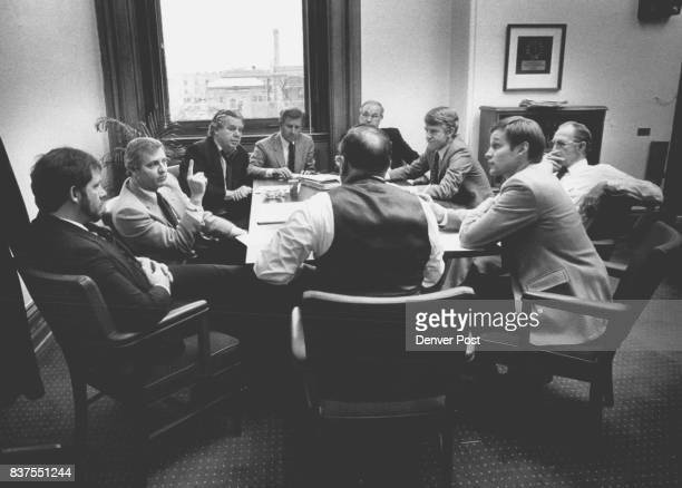 Sen President 2nd from left Ted Strickland raises his finger at members of the House as they met to try to iron out the conflict between the House...