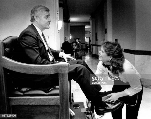 Sen President Ted Strickland gets a shoe shine at the new shoe shine stand in the basement of the Capitol by Jacque Meyer of Classic Shoe Valet...