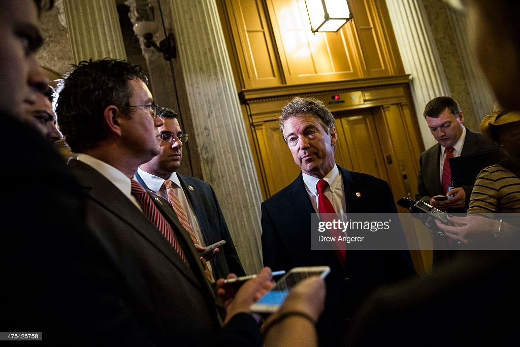 Sen Rand Paul after speaking on the Senate floor about surveillance legislation speaks to reporters after exiting the Senate floor on Capitol Hill...