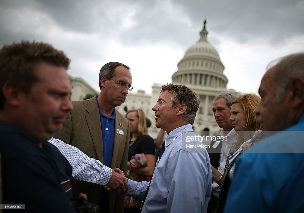 Sen. <a gi-track='captionPersonalityLinkClicked' href=/galleries/search?phrase=Rand+Paul&family=editorial&specificpeople=6939188 ng-click='$event.stopPropagation()'>Rand Paul</a> (R-KY) greets supporters during a Tea Party rally in front of the U.S. Capitol, June 17, 2013 in Washington, DC. The group Tea Party Patriots hosted the rally to protest against the Internal Revenue Service's targeting Tea Party and grassroots organizations for harassment.