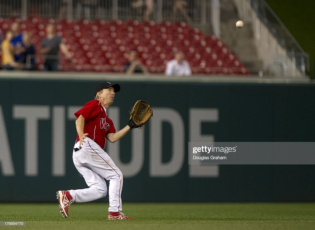 Sen. Rand Paul handles a fly ball to left field during the 52nd annual Congressional Baseball Game at National Stadium in Washington on Thursday, June 13, 2013.