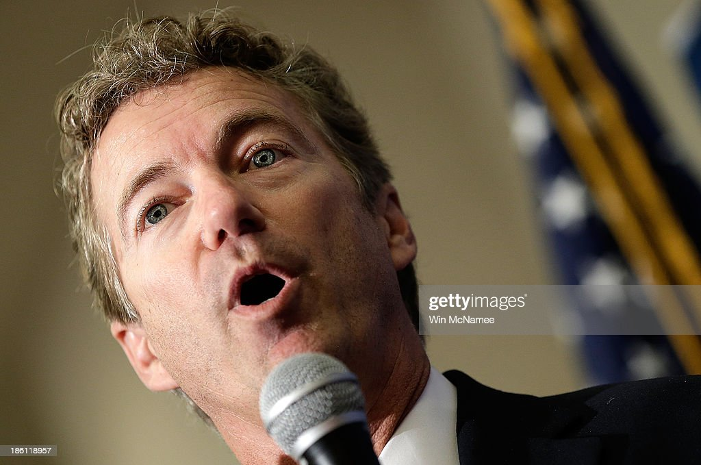 U.S. Sen. <a gi-track='captionPersonalityLinkClicked' href=/galleries/search?phrase=Rand+Paul&family=editorial&specificpeople=6939188 ng-click='$event.stopPropagation()'>Rand Paul</a> listens speaks at a 'Get out the Vote' rally for Virginia Attorney General Ken Cuccinelli, the Republican candidate for Governor of Virginia, October 28, 2013 in Fairfax, Virginia. Cuccinelli is running against Democratic candidate Terry McAullife in a very close race.