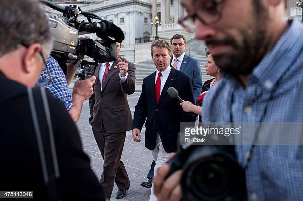 Sen Rand Paul RKy center leaves the US Capitol with Rep Thomas Massie RKy left and Rep Justin Amash RMich right after Sen Paul spoke at length on the...
