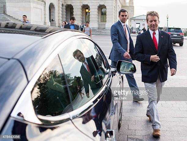 Sen Rand Paul RKy right and Rep Justin Amash RMich leave the US Capitol in Rep Thomas Massie's Tesla after Sen Paul spoke at length on the Senate...